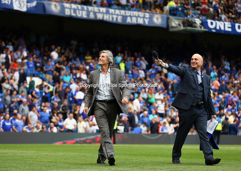 13 September 2014 - Barclays Premier League - Chelsea v Swansea City - Former Chelsea Midfield Player Gary Stanley (L) parades on the pitch at Half Time with Chelse pre-match announcer, Neil Barnett - Photo: Marc Atkins / Offside.