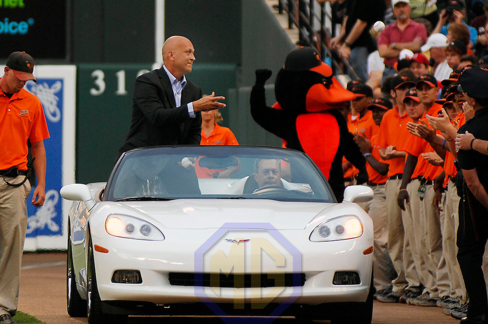 12 July 2007:  Former Baltimore Orioles player Cal Ripken, Jr tosses out autographed baseballs to fans from the back of an automobile as he is driven around the field prior to ceremonies to honor him at a Hall of Fame Send-Off ceremony prior to the game between the Tampa Bay Devil Rays and the Baltimore Orioles.  Ripken will be inducted to the Baseball Hall of Fame Sunday, July 29.  The Orioles defeated the Devil Rays 3-0 at Camden Yards in Baltimore, MD.   ****For Editorial Use Only****.
