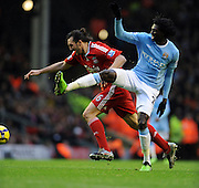 Sotirios Kyrgiakos (Liverpool) & Emmanuel Adebayor (Manchester City) during the Barclays Premier League match between Liverpool and Manchester City at Anfield - 21/11/09