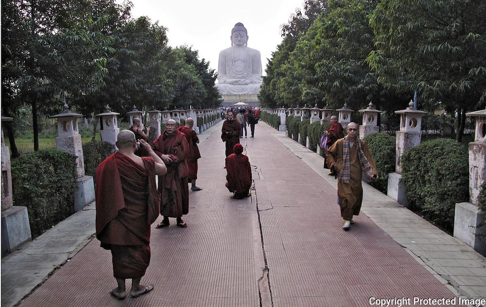 Buddhist monks visit a monument at Bodhgaya, India.