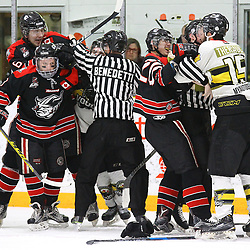 "TRENTON, ON  - MAY 5,  2017: Canadian Junior Hockey League, Central Canadian Jr. ""A"" Championship. The Dudley Hewitt Cup Game 7 between Georgetown Raiders and the Powassan Voodoos.   Referees try to break up a scrum between Georgetown Raiders and Powassan Voodoos during the third period<br /> (Photo by Alex D'Addese / OJHL Images)"