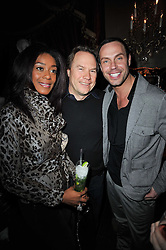 Left to right, PHOEBE VELA, JOHN HITCHCOX and JASON GARDINER at a party to celebrate the publication of her new book - Kelly Hoppen: Ideas, held at Beach Blanket Babylon, 45 Ledbury Road, London W11 on 4th April 2011.