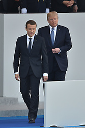US President Donald Trump and French President Emmanuel Macron attend the annual Bastille Day military parade on the Champs-Elysees avenue in Paris on July 14, 2017. Photo by Lionel Hahn/ABACAPRESS.com
