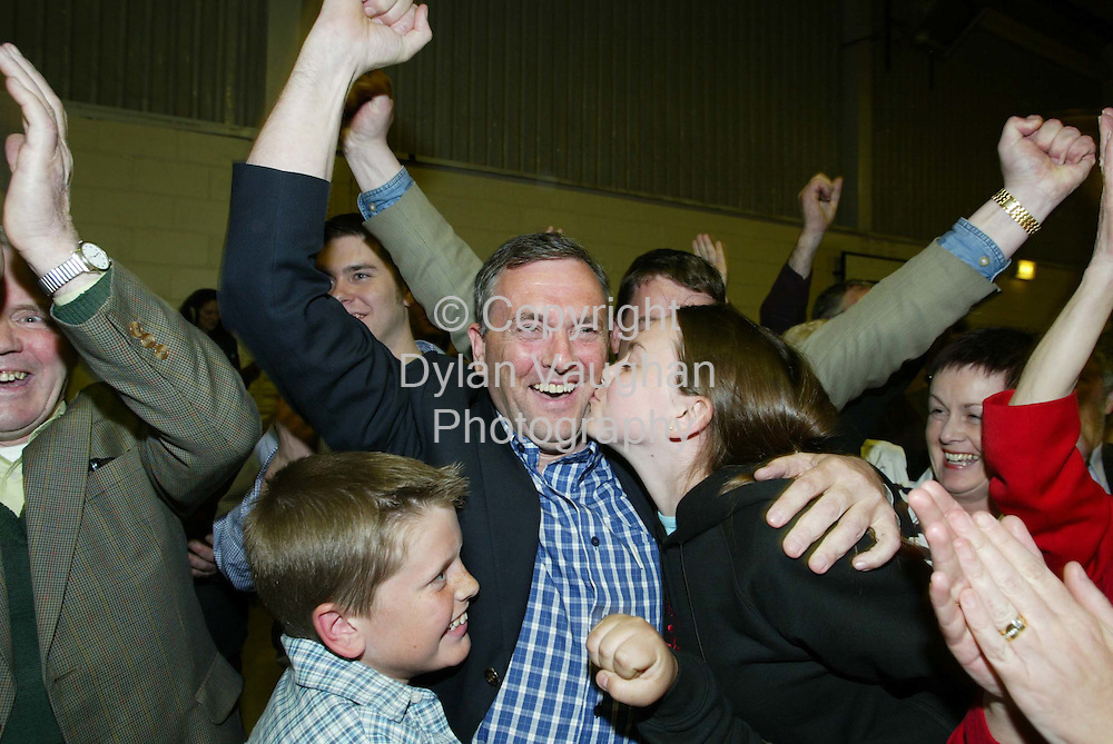 19/5/2002 .Fianna Fails John McGuiness pictured celebrating his election at the count centre in the community hall in Thomastown County Kilkenny..Picture Dylan Vaughan