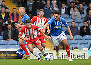 Gary Roberts beats Seamus Conneely to the ball  during the Sky Bet League 2 match between Portsmouth and Accrington Stanley at Fratton Park, Portsmouth, England on 5 September 2015. Photo by Adam Rivers.