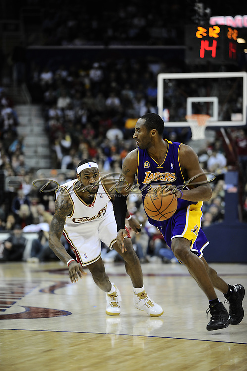 LeBron James of the Cleveland Cavaliers and Kobe Bryant of the Los Angeles Lakers..The Cleveland Cavaliers defeated the visiting Los Angeles Lakers 94-90 at Quicken Loans Arena in Cleveland, December 20, 2007. LeBron James led the Cavs with 33 points while Kobe Bryant paced the Lakers with 21..