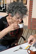 woman having a espresso coffee in the sun