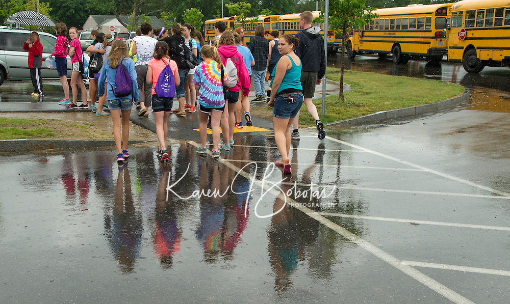 Laconia Middle School student's begin their start of Summer vacation on a wet note after their last day of classes Tuesday afternoon.  (Karen Bobotas/for the Laconia Daily Sun)