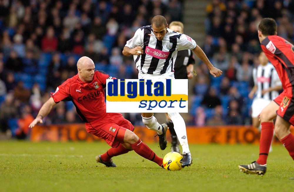 Photo: Leigh Quinnell.<br /> West Bromwich Albion v Coventry City. Coca Cola Championship. 16/12/2006. Coventrys Robert Page challenges West Broms Diomansy Kamara.