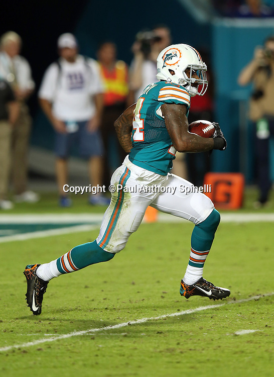 Miami Dolphins wide receiver Jarvis Landry (14) returns a kick during the NFL week 14 regular season football game against the New York Giants on Monday, Dec. 14, 2015 in Miami Gardens, Fla. The Giants won the game 31-24. (©Paul Anthony Spinelli)
