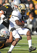 November 10 2012: Purdue Boilermakers running back Akeem Shavers (24) is hit by Iowa Hawkeyes linebacker Christian Kirksey (20) and defensive lineman Joe Gaglione (99) on a run during the NCAA football game between the Purdue Boilermakers and the Iowa Hawkeyes at Kinnick Stadium in Iowa City, Iowa on Saturday, November 10, 2012. Purdue defeated Iowa 27-24.