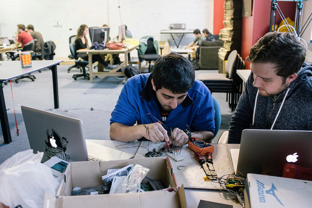 Members of Startup Shell, including Abdullah Abdurrah, left, and Chase Brignac, right, work on a projects to make a larger heatbed for a 3D printer at the Startup Shell headquarters on the University of Maryland campus on April 1, 2015. Startup Shell is a not for profit company run entirely by and for students at UMD. Entrepreneurial students from all different disciplines apply to join and if accepted, can work on their innovative project with others collaborating and teaching one another.
