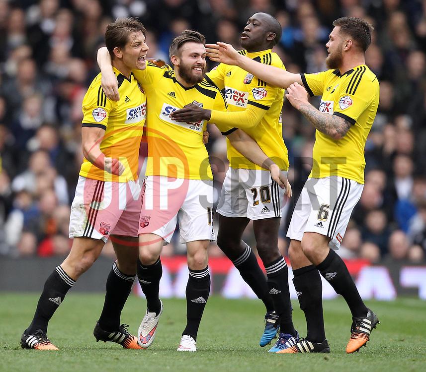 Brentford players celebrate Brentford's Stuart Dallas' goal - Photo mandatory by-line: Robbie Stephenson/JMP - Mobile: 07966 386802 - 03/04/2015 - SPORT - Football - Fulham - Craven Cottage - Fulham v Brentford - Sky Bet Championship