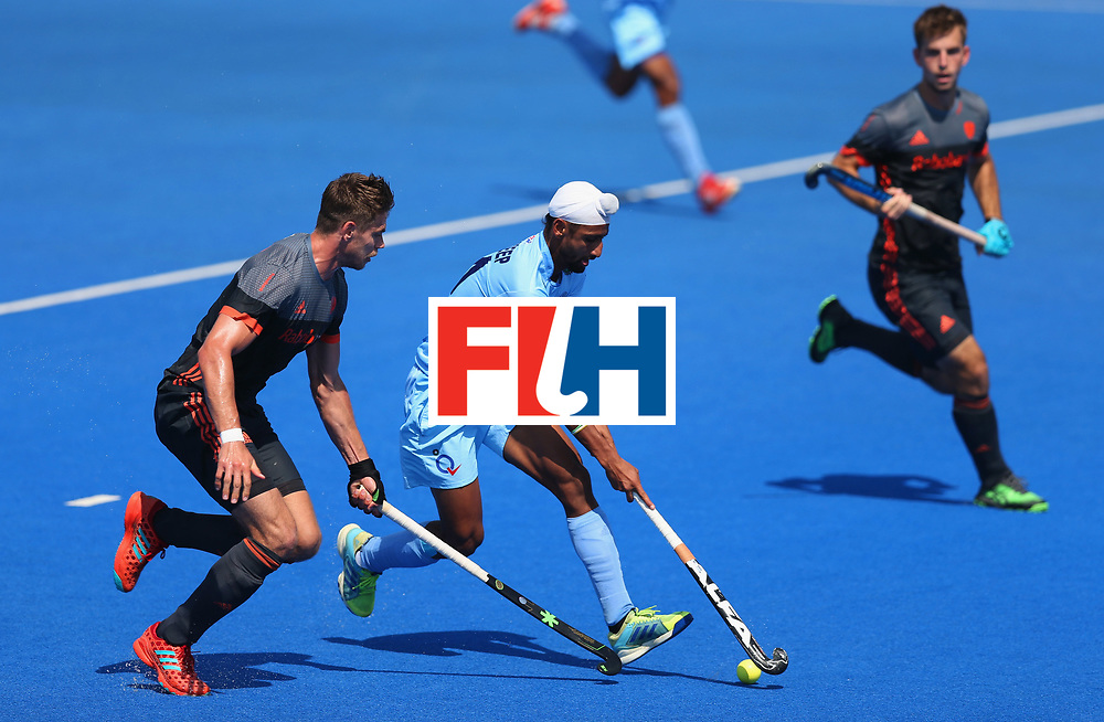 LONDON, ENGLAND - JUNE 20:  Mandeep Singh of India attempts to break through during the Pool B match between India and the Netherlands on day six of the Hero Hockey World League Semi-Final at Lee Valley Hockey and Tennis Centre on June 20, 2017 in London, England.  (Photo by Alex Morton/Getty Images)
