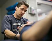 Amerks trainer Rob Frost works on a player on Tuesday, December 2, 2014.