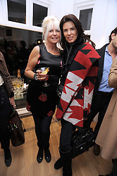 Left to right, LINDSEY CARLOS CLARKE and CHRISTINA ESTRADA-JUFFALI at a private view of 'Most Wanted' an exhibition of photographs held at The Little Black Gallery, Park Walk, London on 27th November 2008.