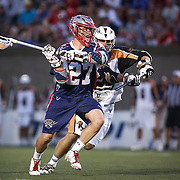 Kevin Buchanan #27 of the Boston Cannons runs with the ball during the game at Harvard Stadium on August 9, 2014 in Boston, Massachusetts. (Photo by Elan Kawesch)