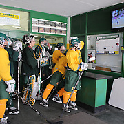 Hamden High School Hockey players watching the finals minutes of regular time during of the Women's Hockey Final at the Winter Olympic games in Sochi Russia. The boys had stopped scrummaging before training to watch the last minutes of the game. Hamden. Connecticut, USA. 20th February 2014. Photo Tim Clayton