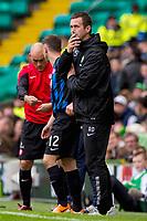 05/10/14 SCOTTISH PREMIERSHIP<br /> CELITC v HAMILTON<br /> CELTIC PARK - GLASGOW<br /> Celtic manager Ronny Deila watches his side on from the dugout