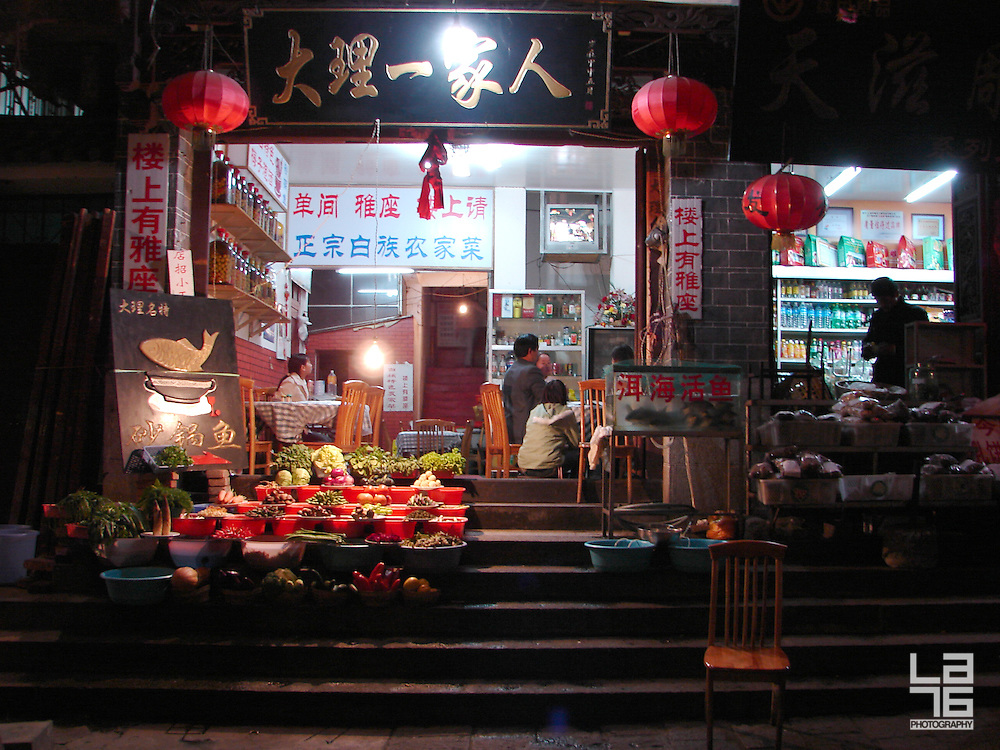 Walking down the Chinese streets at night you will find many local family stores opened late at night. While the father is probably watching TV or having some beers with friends, the mother and the rest of the family are hanging out around the store, waiting for customers. Fresh fruits and vegetables, meet, beverages and other supplies are available.