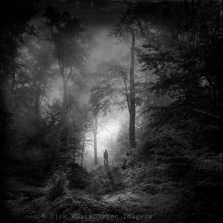 Single person standing in a dark forest scene. Manipulated texturized photograph.<br /> <br /> <br /> Prints:<br /> http://society6.com/DirkWuestenhagenImagery/displaced-IiK_Print