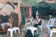 Middle East, Jordan, Petra, UNESCO World Heritage Site. Three European tourists at a coffee break. MR available