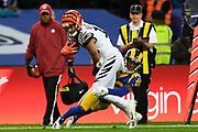 LA Rams Defensive back Troy Hill (22)  tackles Cincinnati Bengals Wide receiver Alex Erickson (12) during the International Series match between Los Angeles Rams and Cincinnati Bengals at Wembley Stadium, London, England on 27 October 2019.