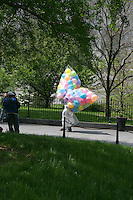 Ballons being carried through City Hall Park, New York City, USA
