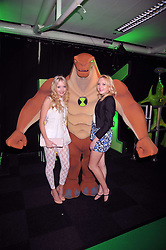 Sisters SAMANTHA MARCHANT and AMANDA MARCHANT with a character from the cartoon at the premier of Ben Ten Alien Force at the Old Billingsgate Market, City of London on 15th February 2009.