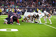 The Miami Dolphins offensive line gets set to snap the ball opposite the Houston Texans defensive line at the line of scrimmage during the NFL week 8 regular season football game against the Houston Texans on Thursday, Oct. 25, 2018 in Houston. The Texans won the game 42-23. (©Paul Anthony Spinelli)
