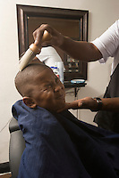 Young boy with the hair being brushed away from his head