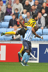 Shrewsburys Nathaniel Knight Percival climbs on Coventrys Marc Antoine Fortune, Coventry City v Shreswsbury Town FC  Ricoh Arena, Football Sky Bet League One, Saturday 3rd October 2015