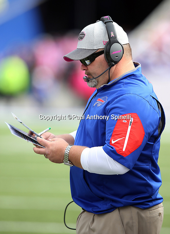 Buffalo Bills offensive coordinator Greg Roman checks out his play chart on the sideline during the 2015 NFL week 4 regular season football game against the New York Giants on Sunday, Oct. 4, 2015 in Orchard Park, N.Y. The Giants won the game 24-10. (©Paul Anthony Spinelli)