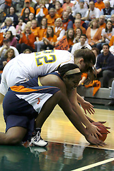 19 March 2010: Philana Greene and Jodie Luther struggle for a loose ball. The Flying Dutch of Hope College defeat the Yellowjackets of the University of Rochester in the semi-final round of the Division 3 Women's Basketball Championship by a score of 86-75 at the Shirk Center at Illinois Wesleyan in Bloomington Illinois.