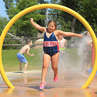 Lovelyn Lindsey, 5, leaps through one of the water rings as she play at the splash pad at Rob Leake Park in Tupelo during a C.A.S.A day trip on Friday morning in Tupelo. The splash pads in Tupelo are open from 10 a.m. until 7 p.m. on Fridays, Saturdays and Sundays. On May 29, Parks and Recreation will open the splash pads all week.
