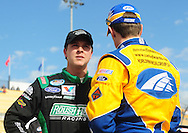 Nov. 12 2011; Avondale, AZ, USA; NASCAR Nationwide Series driver Trevor Bayne (left) talks with Carl Edwards (right) during qualifying for the Wypall 200 at Phoenix International Raceway. Mandatory Credit: Jennifer Stewart-US PRESSWIRE