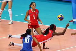 Cuba Daymara Lescay Cajigal digs a ball