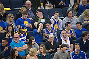 Golden State Warriors fans admire their new engagement ring after a proposal at Oracle Arena in Oakland, Calif., on January 28, 2017. (Stan Olszewski/Special to S.F. Examiner)