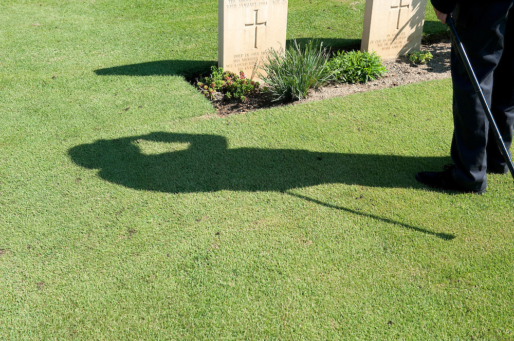 A veteran salutes the graves of his fallen comrades in the Commonwealth War Graves Cemetery,  Anzio, Italy