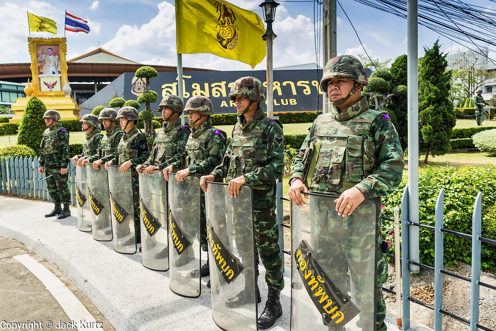 "20 MAY 2104 - BANGKOK, THAILAND:  Thai soldiers guard the Army Club, the venue for meetings between the Thai Army and civilian politicians after the army declared martial law. The Thai Army declared martial law throughout Thailand in response to growing political tensions between anti-government protests led by Suthep Thaugsuban and pro-government protests led by the ""Red Shirts"" who support ousted Prime Minister Yingluck Shinawatra. Despite the declaration of martial law, daily life went on in Bangkok in a normal fashion. There were small isolated protests against martial law, which some Thais called a coup, but there was no violence.  PHOTO BY JACK KURTZ"