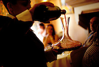 Decanting wine in the restaurant Hostellerie du Nord, in Auvers-sur-Oise, near Paris - © Owen Franken.....