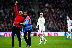 Wayne Rooney of England watches on as a pitch invader is removed from the pitch - Mandatory by-line: Robbie Stephenson/JMP - 15/11/2018 - FOOTBALL - Wembley Stadium - London, England - England v United States of America - International Friendly