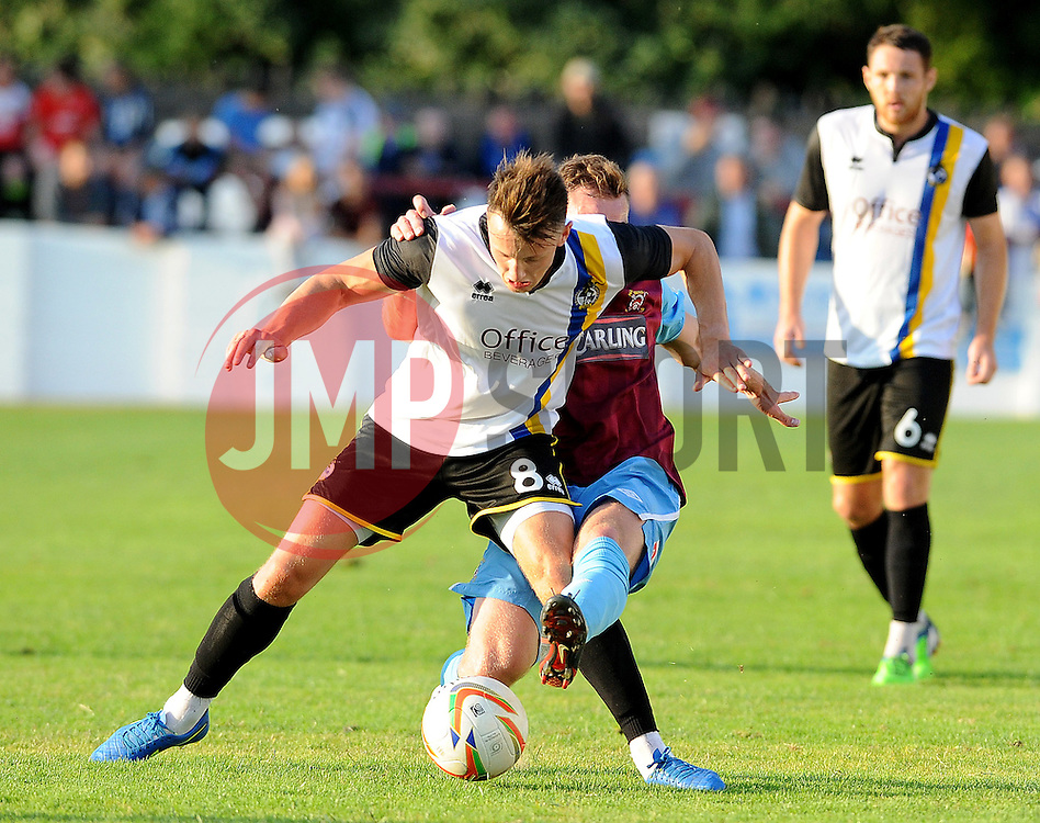 Ollie Clarke of Bristol Rovers on the receiving end of a strong challenge - Photo mandatory by-line: Neil Brookman/JMP - Mobile: 07966 386802 - 15/07/2015 - SPORT - Football - Bristol - Cossham Stadium - Pre-Season Friendly