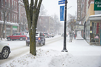 Traffic slows through downtown Laconia as the storm arrives Thursday morning.  (Karen Bobotas/for the Laconia Daily Sun)
