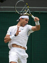 25.06.2011, Wimbledon, London, GBR, Wimbledon Tennis Championships, im Bild Rafael Nadal (ESP) in action during the Gentlemen's Singles 3rd Round match on day six of the Wimbledon Lawn Tennis Championships at the All England Lawn Tennis and Croquet Club, EXPA Pictures © 2011, PhotoCredit: EXPA/ Propaganda/ *** ATTENTION *** UK OUT!