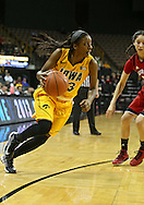 February 11 2013: Iowa Hawkeyes guard Theairra Taylor (23) drives with the ball during the first half of the NCAA women's basketball game between the Nebraska Cornhuskers and the Iowa Hawkeyes at Carver-Hawkeye Arena in Iowa City, Iowa on Monday, February 11 2013.