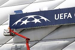 13.05.2012, Allianz Arena, Muenchen, GER, UEFA CL, Allianz Arena, im Bild Allianz Arena Muenchen wird anlaesslich des Finales um die UEFA Champions League umdekoriert und umbenannt; Schriftzug UEFA Champions League und Handwerker mit Hebebuehne an der Fassade des Stadions // the Allianz Arena in Munich is the occasion of the UEFA Champions League Final at the redecorated and renamed, UEFA Champions League logo on the facade of the stadium, Munich, Germany on 2012/05/13. EXPA Pictures © 2012, PhotoCredit: EXPA/ Eibner/ RR     ATTENTION - OUT OF GER *****
