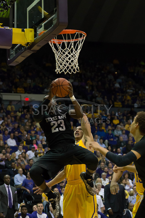 Daniel House(23) of Texas A&M goes up for a layup over Ben Simmons(25) of LSU. LSU defeats Texas A&M 76-71 in Baton Rouge, Louisiana. Photo BY: Jerome Hicks/ Space City Images