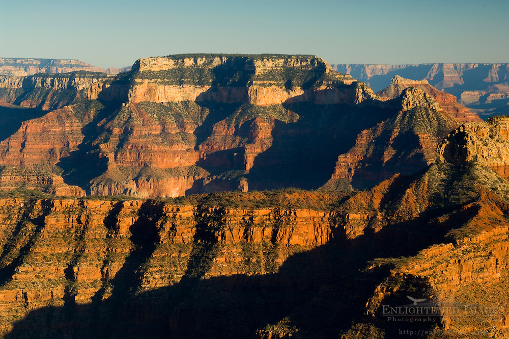 Sunset light on eroded cliffs along the North Rim from Point Sublime, Grand Canyon National Park, Arizona