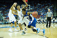 19 MAR 2015: Deron Powers (11) of Hampton pushes past Tyler Ulis (3) of University of Kentucky during the 2015 NCAA Men's Basketball Tournament held at the KFC Yum! Center in Louisville, KY. Kentucky defeated Hampton 79-56. Brett Wilhelm/NCAA Photos
